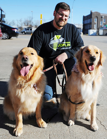 Globe/T. Rob Brown<br /> Jason Glaskey, minister to youth and families at Immanuel Lutheran Church in Joplin, with Jackson, left, and Louie, comfort dogs, Thursday afternoon, Jan. 17, 2013, on South Main Street.