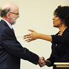 Globe/T. Rob Brown<br /> Brad Belk, executive director of the Joplin Museum Complex, shakes hands with Joplin Mayor Melodee Colbert-Kean after she presented him with one of numerous plaques in honor of his 25 years of service to the city's museum during a ceremony Friday afternoon, Jan. 18, 2013, at the complex in Schifferdecker Park.