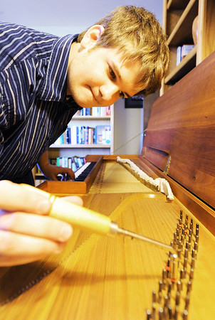 Globe/T. Rob Brown<br /> Christopher Grills, of Loma Linda, tunes a clavichord recently in his home.