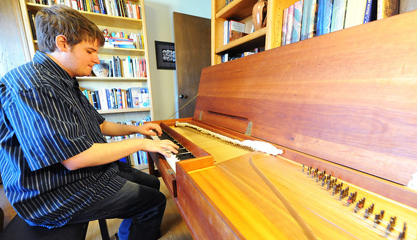 Globe/T. Rob Brown<br /> Christopher Grills, of Loma Linda, plays a clavichord recently in his home.
