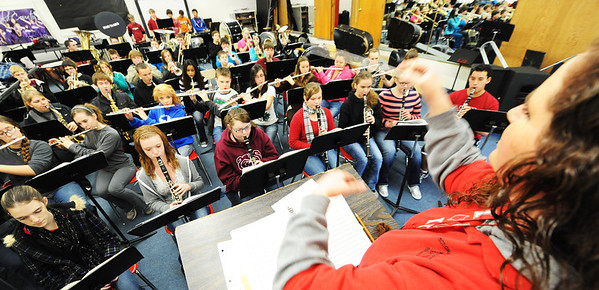 Globe/T. Rob Brown<br /> The McDonald County High School band practices Friday morning, Jan. 4, 2013, under the direction of Laurie Kinder-Lang in the school's band room for their upcoming presidential performance.
