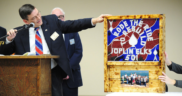 Globe/T. Rob Brown<br /> Joplin Elks Lodge #501 Exalted Ruler Charles Sorenson shows a gift to the lodge after unwrapping it Saturday afternoon, Jan. 12, 2013, during the New Facility Grand Opening event.