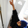 Globe/T. Rob Brown<br /> New York University student Saad Khan helps spackle a door frame of a Rebuild Joplin home Monday afternoon, Jan. 21, 2013, in the 1900 block of Illinois Avenue, as part of an interfaith effort involving Jews and Muslims.