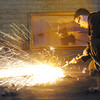 Globe/T. Rob Brown<br /> Chris Anderson, of Osceola, a regulator operator with CDL Electric Company Inc. Rail Maintenance Division, uses a welding torch to remove unwanted metal at the former McNally Pittsburg Manufacturing Corp. facility in Pittsburg, Kan., Thursday morning, Jan. 24, 2013. The building was recently purchased by CDL Electric Company Inc.