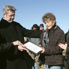 Globe/Roger Nomer<br /> (from left) Stephen Bergen, case manager and volunteer coordinator with Samaritan's Purse, Daniel Wermuth, lead pastor at Joplin Family Worship Center, Rhonda Wilkins and Patricia Bryan say a prayer over the deed to 2204 S. Grand on Thursday afternoon.