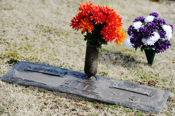 Globe/T. Rob Brown<br /> Flowers on the grave of Maj. Robert E. Hill Jr. Wednesday afternoon, Jan. 23, 2013, in Osborne Cemetery in Joplin. He died in a B-52 test flight 50 years ago.