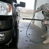 Globe/Roger Nomer<br /> Sgt. First Class Ron Collins washes the slush off of his truck at the Majestic Car Wash in Pittsburg on Monday.