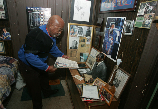 Globe/Roger Nomer<br /> Floyd Cavitt looks through years of memories from organizing the Martin Luther King Day celebration in Oswego.