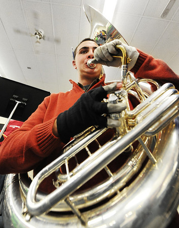 Globe/T. Rob Brown<br /> Junior Ben Hamilton practices the tuba with the rest of the band Friday morning, Jan. 4, 2013, in Laurie Kinder-Lang's class at McDonald County High School's band room for their upcoming presidential performance.