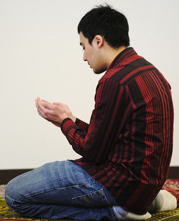 Globe/T. Rob Brown<br /> Saad Khan, a New York University student, participates in a prayer service at the temporary mosque for the Islamic Society of Joplin Friday afternoon, Jan. 25, 2013. Khan was part of an interfaith service organization of New York University students, including Muslims and Jews, which recently spent a week in Joplin and Rebuild Joplin to help with the tornado rebuilding effort. The mosque's former location was burned down, suspected arson, in early August 2012.