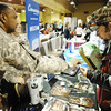 Globe/T. Rob Brown<br /> Sgt. 1st Class Eric Jackson hands recruiting materials to Jeffrey Bender of Joplin during the 2013 Job Fair Tuesday afternoon, Jan. 29, in a crowded Holiday Inn Convention Center.