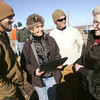 Globe/Roger Nomer<br /> Rhonda Wilkins and her sons, Matt, left, and Seth talk with Patricia Bryan after she donated land at 2204 S. Grand on Thursday.