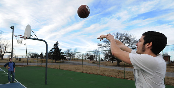 """Globe/T. Rob Brown<br /> Karl Keczkemethy, right, throws the basketball in an attempt to win a game of """"Around the World"""" with friend Christopher White under the cloudy sky at Schifferdecker Park in Joplin Tuesday afternoon, Jan. 8, 2013."""