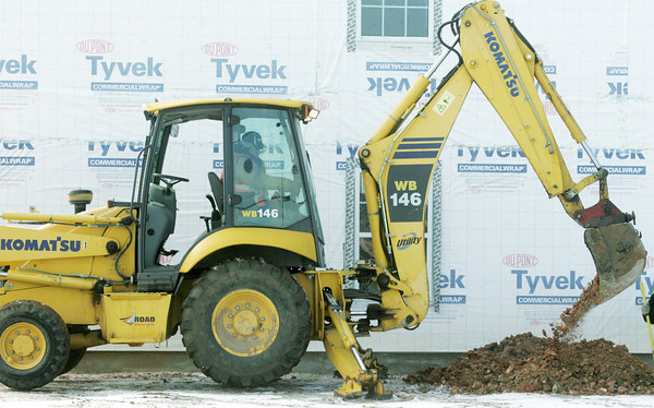 Globe/Roger Nomer<br /> Using an excavator, a worker digs a trench at the New Hampshire Terrace Apartments on Tuesday afternoon.