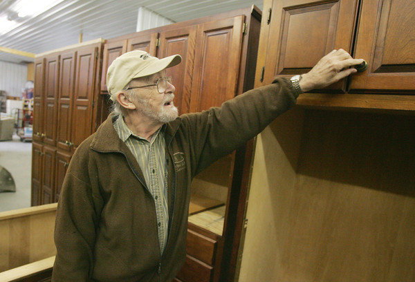 Globe/Roger Nomer<br /> Galen McKinley shows a set of cabinets to a customer at the Habitat for Humanity Restore in Joplin on Thursday afternoon.