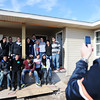 Globe/T. Rob Brown  An interfaith group of New York University students and some Rebuild Joplin members pose for a photo by Ben Harrison, right, of Lamar, a Rebuild Joplin site supervisor, Friday morning, Jan. 25, 2013, on the porch of a Rebuild Joplin home on 18th Street. The interfaith service organization of NYU students, including Muslims and Jews, helped with tornado rebuilding efforts this week.
