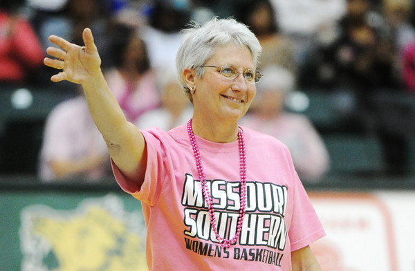 Globe/T. Rob Brown<br /> Missouri Southern State University's Pat Lipira waves to the crowd between the women's and men's basketball games Saturday afternoon, Jan. 19, 2013, at MSSU's Leggett & Platt Athletic Center. MSSU's women wore pink uniforms and auctioned them off with the proceeds going toward cancer research. Lipira and several other cancer survivors were recognized.