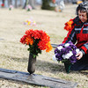 Globe/T. Rob Brown<br /> Bobbie Hill puts flowers next to the grave of her father, Maj. Robert E. Hill Jr. Wednesday afternoon, Jan. 23, 2013, in Osborne Cemetery in Joplin. He died in a B-52 test flight 50 years ago.