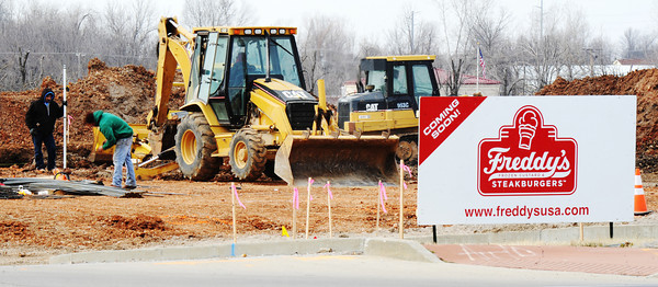 Globe/T. Rob Brown<br /> Construction continues at the new location for Freddy's Frozen Custard & Steakburgers Tuesday afternoon, Jan. 22, 2013, on South Range Line Road, just north of 32nd Street. The former Joplin location was destroyed by the May 22, 2011, tornado.