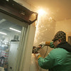 Globe/Roger Nomer<br /> Daniel Reyes, with Cornerstone Detention Products, removes an old detention door at the Jasper County Jail on Wednesday.