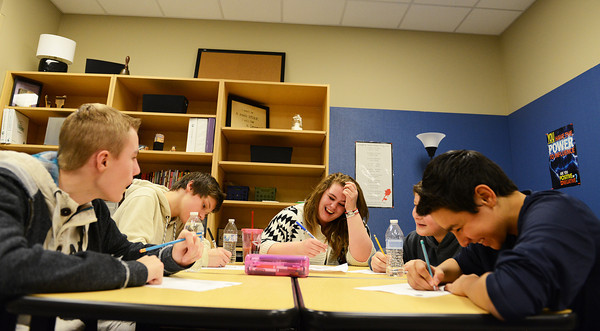 Globe/Roger Nomer<br /> (from left) East Middle School eighth graders Logan Allen, Payton Layne, Kylie Shelton, Gabriel Avila and Brandon Hadel work on an assignment for their WEB class on Thursday.