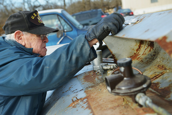 Globe/Roger Nomer<br /> Thomas Spencer checks the level of propane in his tank on Thursday.