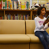 Globe/Roger Nomer<br /> Faith Neal, fourth grade, reads from a book in the fully-stocked and new library at Irving Elementary on Thursday.