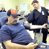 Karen Ringler, supervisor at Community Blood Center of the Ozarks, assists regular donor Pete Negro, Joplin, as he gives blood on Wednesday at the center. Workers at the center said they have noticed a definite spike in the number of donors since a Code Red alert for blood was issued.<br /> Globe | Laurie Sisk