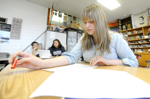 Susannah Schrader, McAuley junior, edits a story during her seventh period class on Wednesday. Susannah's aunt, Kaari Schrader, serves as advisor for media students at the school.<br /> Globe | Laurie Sisk