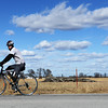 Globe/Roger Nomer<br /> Rob Jones watches for traffic as he crosses an intersection in Southeast Kansas during his cross-country ride on Thursday.