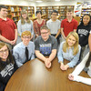 McAuley's Honors English students pose for a photo with their media adviser, Kaari Schrader (fourth from the left, back row) on wednesday, Jan. 22, 2014. Front row, left to right: Abby Pekarek, Jon Pekarek, Logan Allgood, Ashley Baumhover and Kate Supplee. Back row: Frank Ostmeyer, Steven Patrick, Susannah Schrader, Kaari Schrader, James Ngyuen, Nathan Teeter, Cydney Churchwell and Thien Le.<br /> Globe | Laurie Sisk