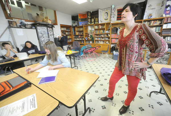 Kaari Schrader, right, briefs her seventh period class on expectations for the day on Wednesday at McAuley High School.<br /> Globe | Laurie Sisk