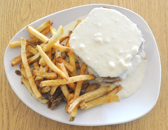 The Croque Monsier features grilled ham and gruyere on wheatberry bread. The entree is topped with mornay sauce and served with a choice of traditional fries or carrot fries.<br /> Globe   Laurie Sisk