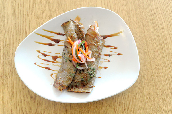 The Chive Crepe consists of smoked salmon and goat cheese wrapped in a chive crepe. The entree is topped with sunomono (Japanese pickled vegetables) and a soy reduction sauce.The item is one of several entrees featured on the restaurant's menu.<br /> Globe | Laurie Sisk