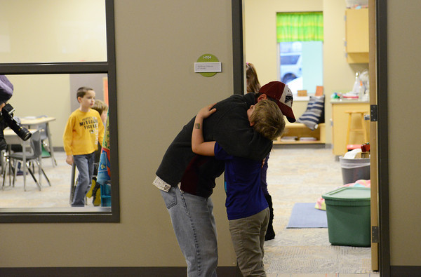 Globe/Roger Nomer<br /> Ken Castleberry gives a hug to his son Mitchell, a second grader at Soaring Heights, on the first day back from winter break on Thursday.
