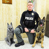 Joplin Police Department K-9 handler Jeremy Bland with Pax, a 2-year-old German shepherd Monday afternoon, Jan. 6, 2014, at the department's main offices in downtown Joplin. The German shepherd statue is in memory of Cezar, a Joplin K-9 who was killed in the line of duty.<br /> Globe | T. Rob Brown