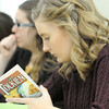 Missouri Southern sophomore Mackenzie Christensen takes notes during a lecture on Tuesday in Dale Simpson's ENG 371 class: Tolkien.<br /> Globe | Laurie Sisk