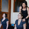 Globe/Roger Nomer<br /> Dai Flake helps Staci Hundt, left, and Sherri Garvin with a yoga pose on Wednesday morning.