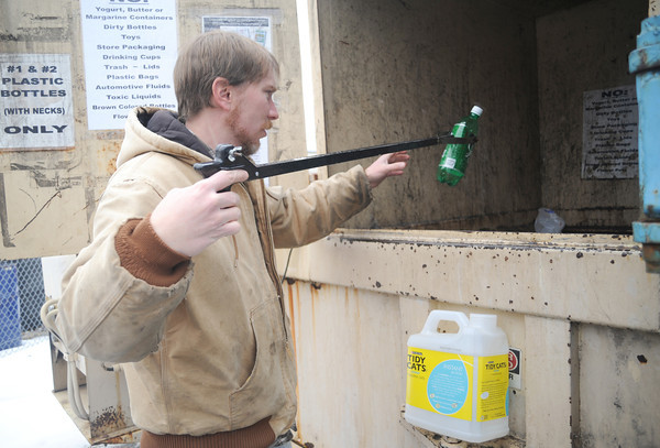 Jonathan Wedge, attendant at the Joplin Recycling Center, arranges plastic bottles in a compactor on Wednesday at the facility.<br /> Globe | Laurie Sisk