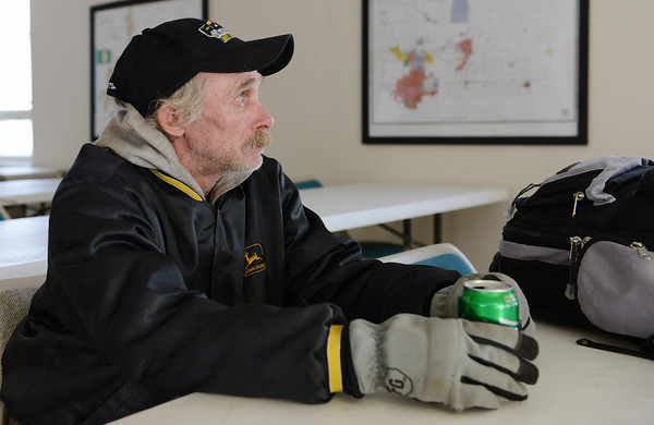 Globe/Roger Nomer<br /> Billy Flynn, Paradise, Calif., waits at the Red Cross warming station in Joplin on Monday. Flynn was passing time until his bus left tonight to travel home to California.
