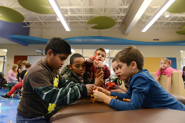 Globe/Roger Nomer<br /> (from left) Second graders AK Eliam, Dontrell Holt, Ojay Pennineton, Gage Pippin and Brayden Windle play during an indoor recess in one of Irving Elementary's Learning Parks.