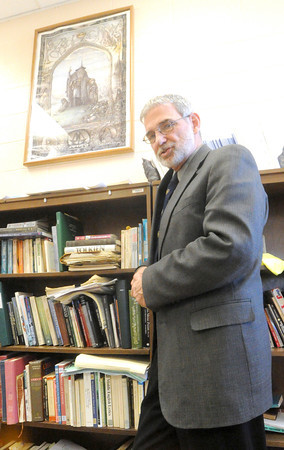 Missouri Southern professor Dale Simpson stands near a bokcase in his campus office on Tuesday after his ENG 371 class: Tolkien.<br /> Globe | Laurie Sisk