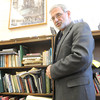 Missouri Southern professor Dale Simpson stands near a bokcase in his campus office on Tuesday after his ENG 371 class: Tolkien.<br /> Globe   Laurie Sisk