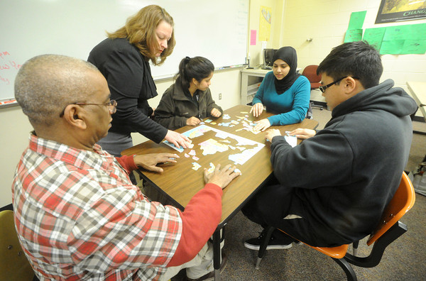 From the left: Abdullah Alsanea, Saudi Arabia, instructor Kimberly Kester, Katherine Martinez-Miranda, Panama, Ghadah Alanazi, Saudi Arabia and Nhon Nguyen, Vietnam work to piece together a puzzle of the United States on Friday at Missouri Southern State University. The exercise was aimed at helping international students learn the geography of the United States.<br /> Globe | Laurie Sisk