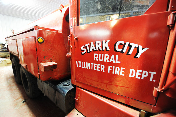 One of the old Star City Fire Department tanker trucks Thursday afternoon, Jan. 9, 2014, at the department. The department hopes to combine with the Fairview Fire Department and get a tax levy to make necessary upgrades.<br /> Globe | T. Rob Brown