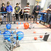High school students from Joplin and Belton compete in the Vex Robotics competition on Friday during a regional conference for the Technology Students Association at Missouri Southern State University. <br /> Globe | Laurie Sisk