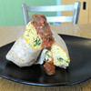 "The Run Around is a whole wheat tortilla stuffed with scrambled eggs, monterey jack and cheddar cheeses, cilantro, green onions, roasted red peppers and avocado. The dish is cooked with olive oil and covered with ""house made"" salsa. The item is one of several entrees  available on the breakfast menu.<br /> Globe 