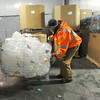 Volunteers Mike Smith, left and Don Wade move plastic containers in preparation for recycling on Thursday at the SEK Recycling Center.<br /> Globe | Laurie Sisk