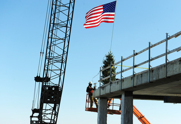Globe/Roger Nomer<br /> The last beams are placed on Via Christi's Surgery Center in Pittsburg during a ceremony on Friday morning.