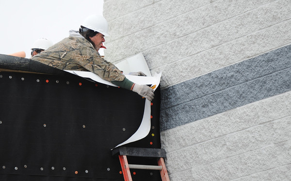Chris Long, a roofer with Mid-America Roofing of Frontenac, Kan., works on the roof of the new expansion Wednesday afternoon, Jan. 8, 2014, at Spring Grove Elementary School in Galena, Kan.<br /> Globe   T. Rob Brown